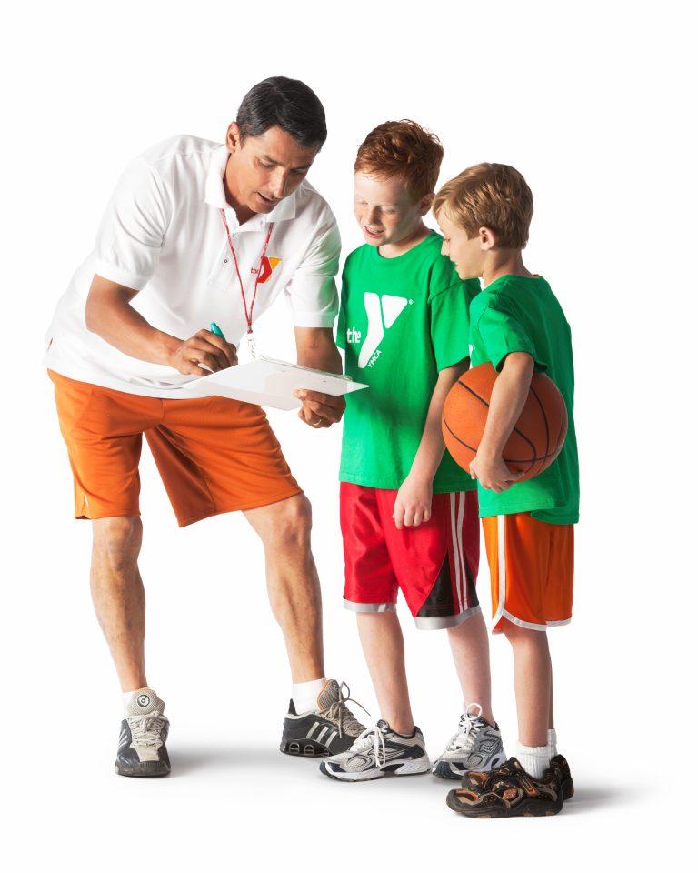 Basketball coach coaching two children
